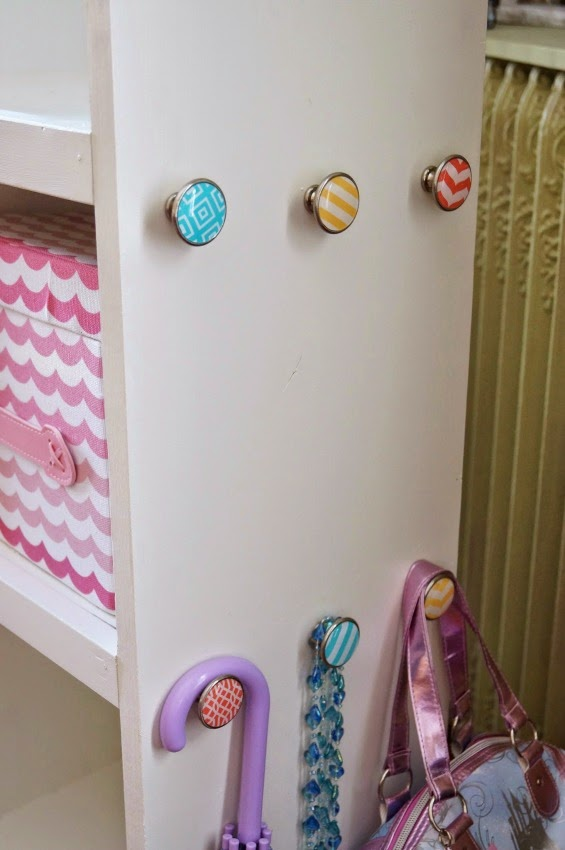 Don't you just love those custon knobs on the side of this unit for hanging cute dress up gear?