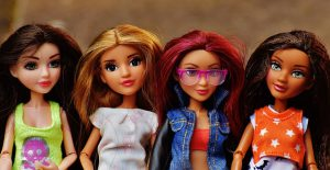 Activities for 4 year olds include playing with barbies and superhero figurines!